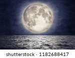 full moon over sea surface with ... | Shutterstock . vector #1182688417