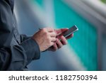 close up of a man using mobile...   Shutterstock . vector #1182750394