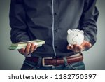 business holding money and...   Shutterstock . vector #1182750397