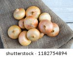 onions on a wooden background. | Shutterstock . vector #1182754894