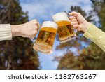 friends clinking with beer mugs ... | Shutterstock . vector #1182763267