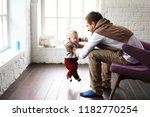 father and little son play in... | Shutterstock . vector #1182770254