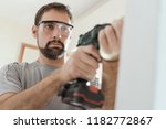 professional repairman with... | Shutterstock . vector #1182772867