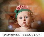 Little Baby Boy In Elf Hat Wit...