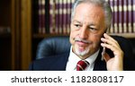 lawyer in office answering the... | Shutterstock . vector #1182808117