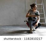professional repairwoman with... | Shutterstock . vector #1182810217