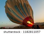hot air balloon flying over... | Shutterstock . vector #1182811057