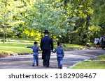 A family of Hasidic Jews, a man with children, walks through the Autumn Park in Uman, Ukraine, Religious Orthodox Jew, Jewish New Year holiday