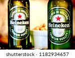 pair of heineken beer bottles | Shutterstock . vector #1182934657
