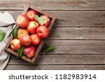 ripe red apples in wooden box.... | Shutterstock . vector #1182983914