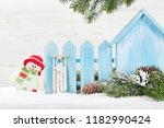 christmas snowman and sledge... | Shutterstock . vector #1182990424
