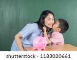 asia boy and his mother with... | Shutterstock . vector #1183020661