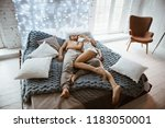 couple in the bedroom on the... | Shutterstock . vector #1183050001