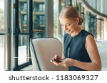 woman using mobile phone in the ... | Shutterstock . vector #1183069327