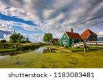zaandam  holland  an old mill... | Shutterstock . vector #1183083481