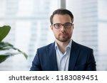 portrait of serious millennial... | Shutterstock . vector #1183089451