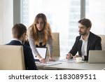 mad female worker talking to... | Shutterstock . vector #1183089511