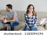 offended husband and wife sit... | Shutterstock . vector #1183094194