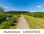footpath towards the dam of the ...   Shutterstock . vector #1183107631