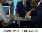 colleagues discussing project... | Shutterstock . vector #1183168327