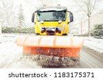 Snowplow Removes Snow Off Icy...