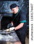 the cook prepares pizza in... | Shutterstock . vector #1183176607