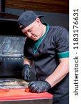 the cook prepares pizza in... | Shutterstock . vector #1183176631
