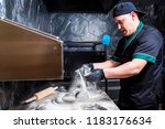 the cook prepares pizza in... | Shutterstock . vector #1183176634