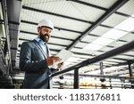 a portrait of an industrial man ... | Shutterstock . vector #1183176811
