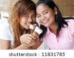 cute young asian girls eating... | Shutterstock . vector #11831785