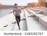 man running in urban area | Shutterstock . vector #1183181767