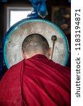 Small photo of IVOLGINSKY DATSAN, ULAN UDE, SIBERIA, RUSSIA - MARCH 24, 2018: Buryat buddhist monk are praying at the Dzogchen Dugan in Ivolginsky datsan