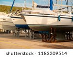 ships are waiting for repairs... | Shutterstock . vector #1183209514