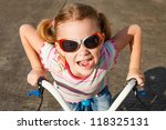 happy child on a bicycle | Shutterstock . vector #118325131