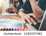 young asian man designer using... | Shutterstock . vector #1183257481