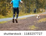 man running in the park | Shutterstock . vector #1183257727