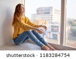 a woman in jeans and a sweater... | Shutterstock . vector #1183284754
