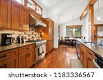 open kitchen room with dining... | Shutterstock . vector #1183336567