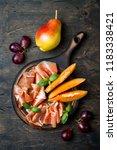 jamon serrano or prosciutto... | Shutterstock . vector #1183338421