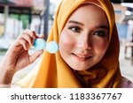 women in hijab shows contact...