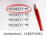 Small photo of Number one priority marked with red circle on math notebook