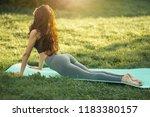 woman practicing yoga...   Shutterstock . vector #1183380157