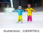 children skating on indoor ice... | Shutterstock . vector #1183407811