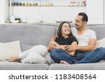 happy couple hugging on the... | Shutterstock . vector #1183408564