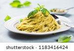 pasta spaghetti with basil... | Shutterstock . vector #1183416424
