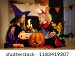 little girl in witch costume... | Shutterstock . vector #1183419307