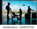 mother with kids and luggage... | Shutterstock . vector #1183419724