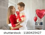 young couple with gift box... | Shutterstock . vector #1183425427