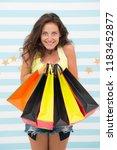 happy shopper girl with... | Shutterstock . vector #1183452877