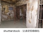 cell on an old prison or jail | Shutterstock . vector #1183508881